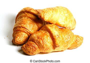 Croissant isolated on white background macro close up