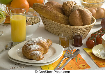 breakfast - Croissant, juice, bread, fruits and coffee...