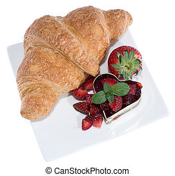 Croissant on a plate with jam