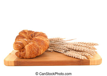 Croissant on cutting board