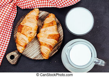 croissant on wooden table, top