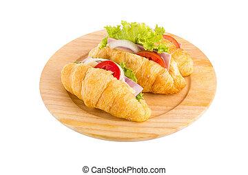 croissant sandwich ham on wooden plate