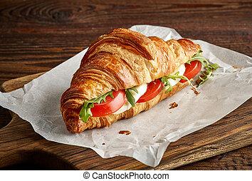 Croissant sandwich with mozzarella and tomato