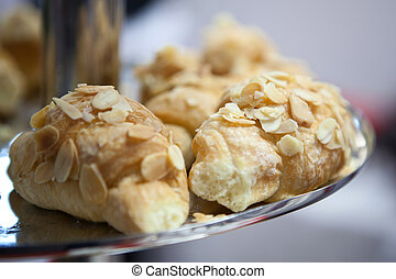 croissant with almonds on a plate