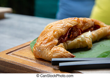 Croissant with bacon cheese