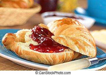 Croissant with butter and strawberry jam (Selective Focus, ...