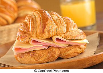 Croissant with Ham and Cheese - Fresh croissant with ham and...