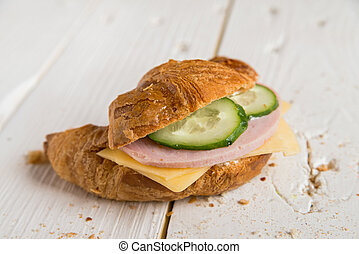 Croissant with ham, cheese and cucumber