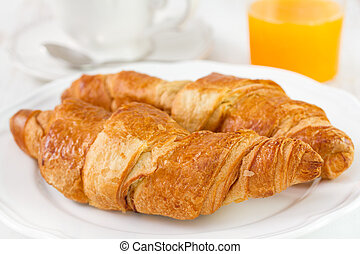 croissant with tea and orange juice