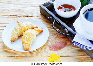 croissants and coffee cup
