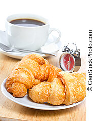 croissants and coffee - breakfast with croissants and coffee