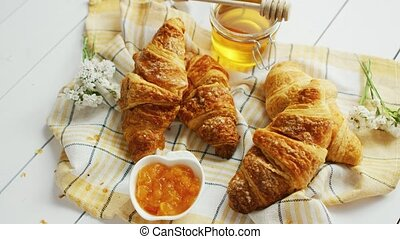 Croissants and condiments composition - From above shot of...