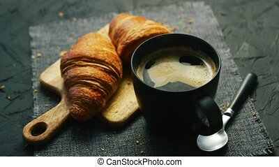 Croissants and cup of coffee - From above view of two fresh...