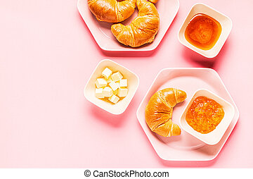 croissants for breakfast on a pink background