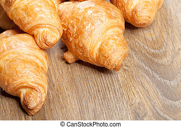 croissants on a wooden background with copyspace