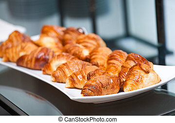 Croissants on the white plate