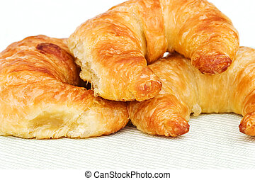 Croissants - Three croissants on a light background