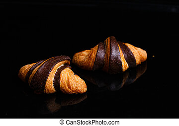 Croissants with chocolate. Homemade pastries, croissants decorated with chocolate.