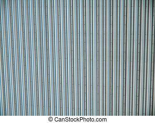 Crome Metal Line pattern on side of building