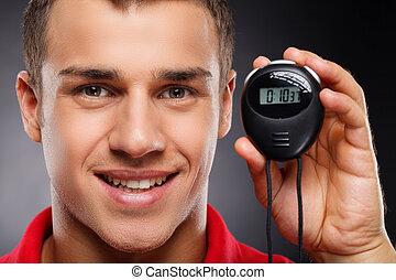 cronômetro, retrato, treinador, jovem, stopwatch.