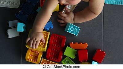 Crop child playing with construction toys - Crop child from...