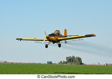 Crop Duster Airplane - Crop duster spraying pesticides on ...