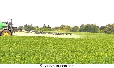 crop fertilizer spray - tractor spray liquid fertilizer on...