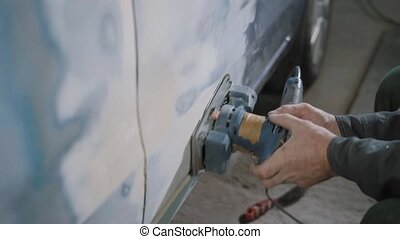 Crop hands sanding car - Crop hands of car mechanic sanding...