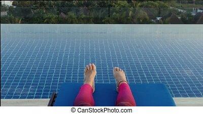 Crop legs near swimming pool - Crop legs of barefoot woman...
