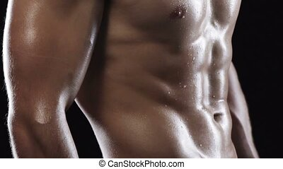 Crop of man with muscular torso - Cropped closeup of strong...