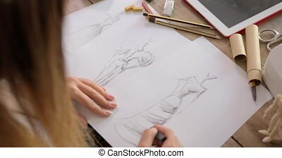 Crop shot of dressmaker drawing sketches - Crop faceless ...
