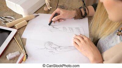 Crop shot of dressmaker drawing sketches - Crop faceless...