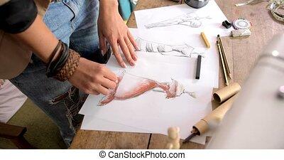 Crop shot of female drawing sketch - Crop faceless shot of...
