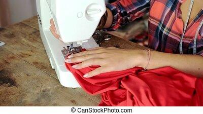 Crop shot of tailor in work - Crop faceless shot of female...