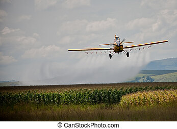 Crop sprayer in action spraying chemicals on a crop of mealies