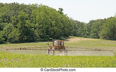 Crop Sprayer - Crop sprayer applying chemicals to a corn...