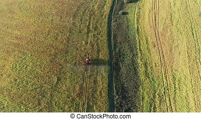 Crop spraying aerial view - Flying behind a bright red ...