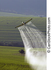 Plane spraying crops in Western Cape, South Africa