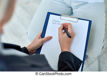Crop therapist taking notes on meeting