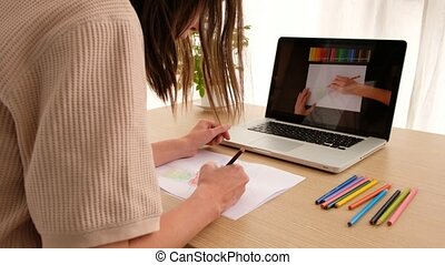 Crop unrecognizable illustrator drawing using laptop with ...