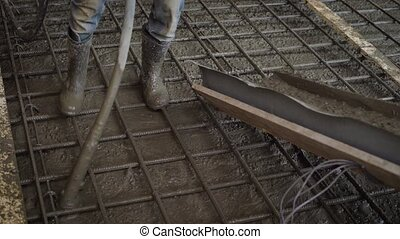 Crop unrecognizable worker pouring cement to fittings on...