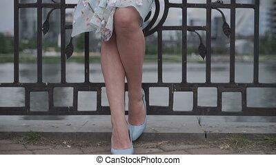 Crop woman holding dress