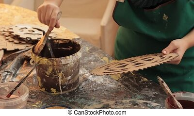 Crop woman painting cardboard items - Faceless view of woman...