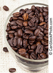 close up image of coffee beans in cup