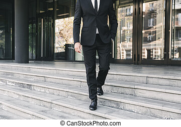 Cropped image of a businessman dressed in suit