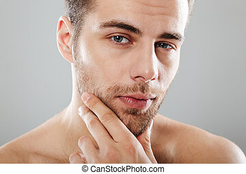 Cropped image of a handsome bearded man