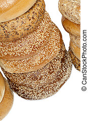 a pile of bagel breads