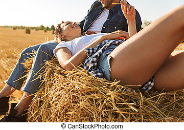 Cropped image of a young couple relaxing together
