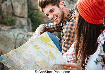 Cropped image of adventure couple with map near the canyon