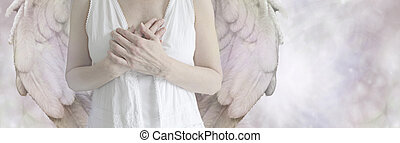 Angel - Cropped image of an Angel holding hands over heart...